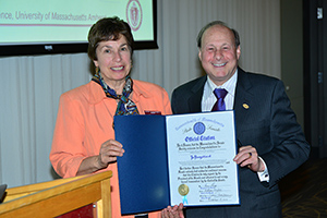 Senator Stanley Rosenberg presents CS Chair Lori Clarke with Senate Citation