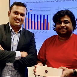Tauhidur Rahman, left, and Forsad Al Hossain display the FluSense device they invented