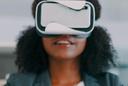 Photo: Woman wearing virtual reality (VR) headset